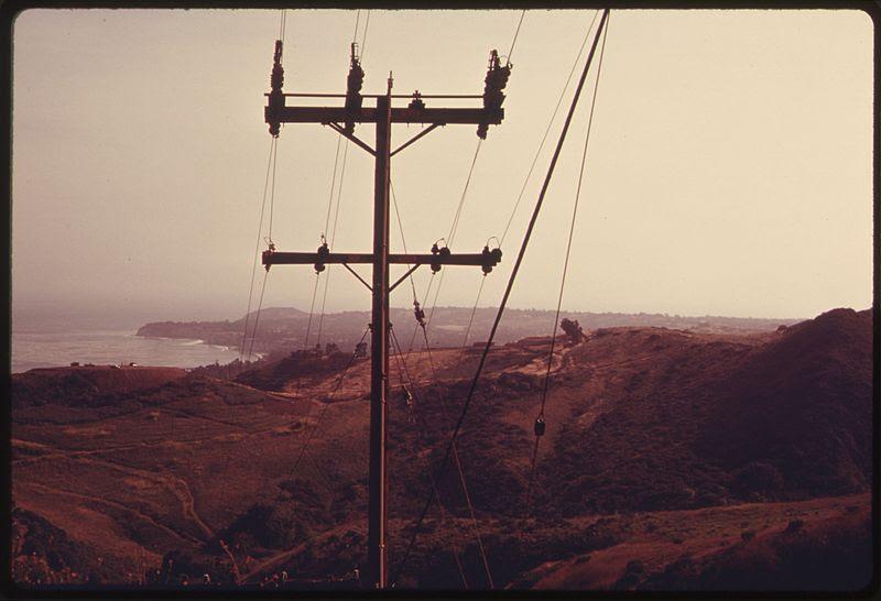File:SIGNS OF CIVILIZATION LOOM OVER THE SANTA MONICA MOUNTAINS NEAR MALIBU, CALIFORNIA, ON THE NORTHERN EDGE OF LOS... - NARA - 557525.jpg