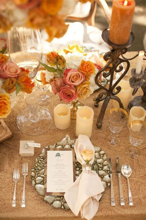 Gorgeous table setting with orange, champagne and tan