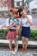 Cute Shibuya Girls w/ High Waisted Shorts, Double Bun Hair & Sing-a-ma-jigs