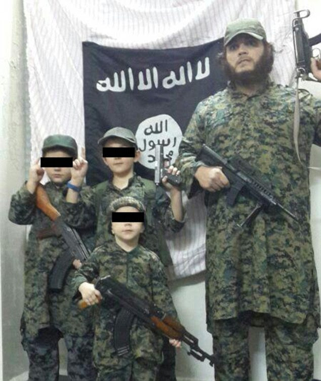 Sharrouf also uploaded a photo of him and his sons dressed in identical camouflage fatigues wielding machine guns