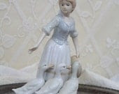 Porcelain figurine of woman with geese - pale blue and white