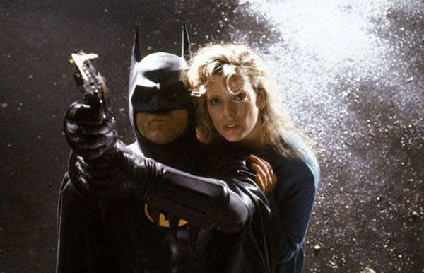 Michael Keaton (as the Dark Knight) and Kim Basinger (as Vicki Vale) in Tim Burton's 1989 hit film, BATMAN.