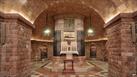 The tomb of St Francis of Assisi in the crypt in the lower church of Assisi's Basilica, Italy
