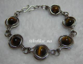 Twice around the world wire wrap bracelet with tiger eye