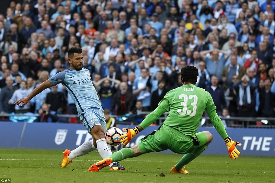 Sergio Aguero finishes off a sublime counter-attack and chips Petr Cech to fire City into the lead just past the hour mark