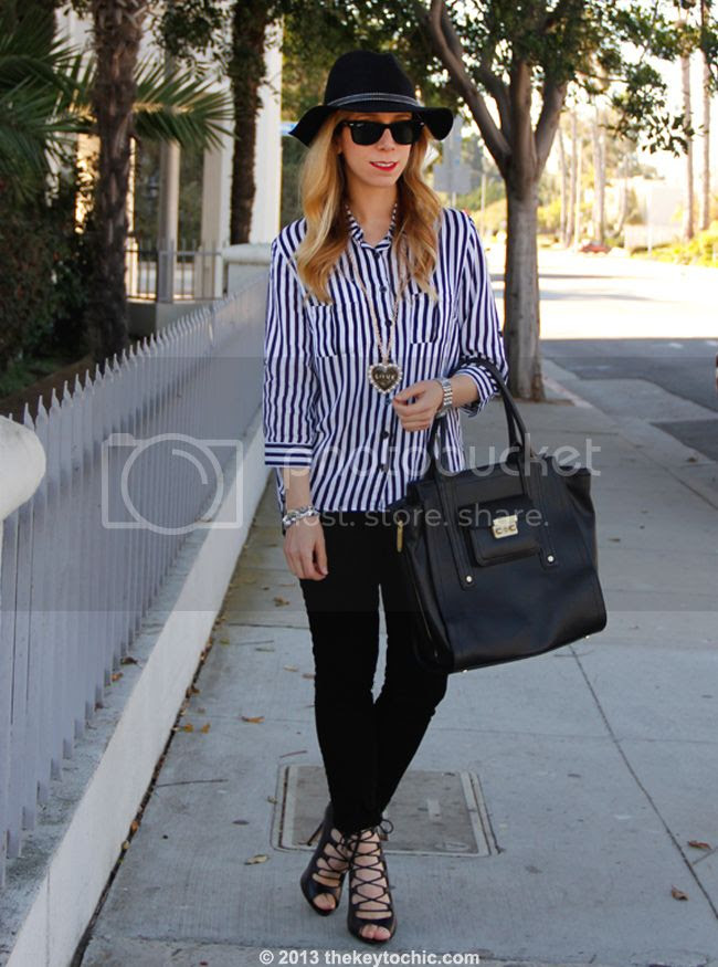 Los Angeles fashion blogger The Key To Chic wears a striped blouse from AMI Clubwear, J Brand skinny jeans, a Boohoo hat, Zara lace-up heels, and a Phillip Lim for Target tote bag