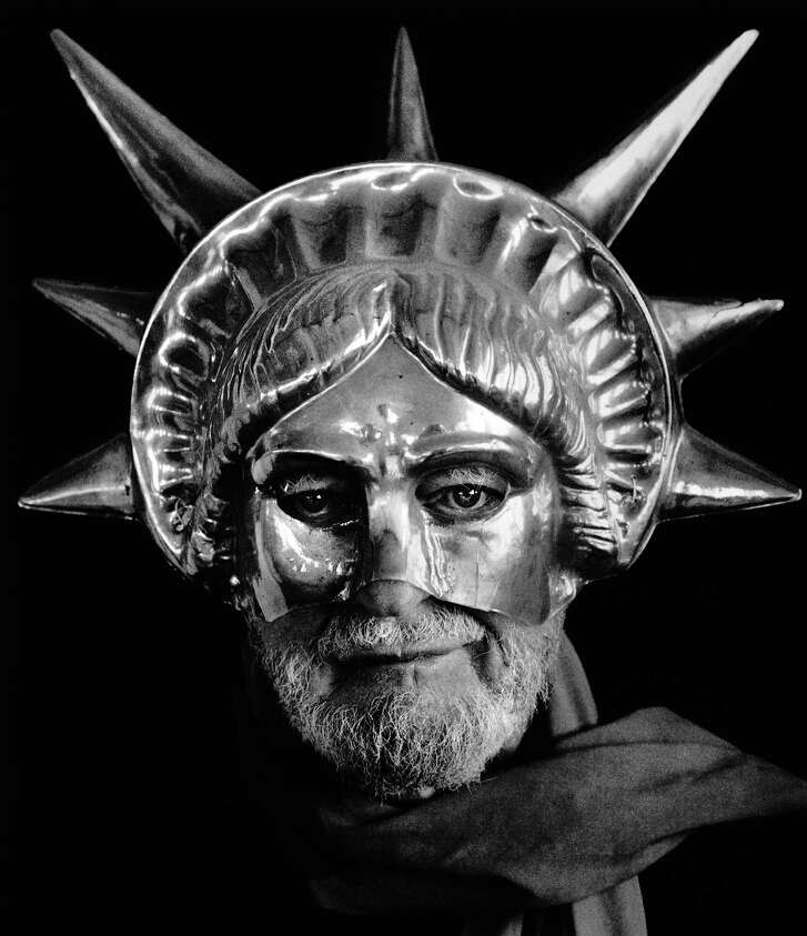 Lawrence Ferlinghetti wears a Statue of Liberty mask in San Francisco in 1982.