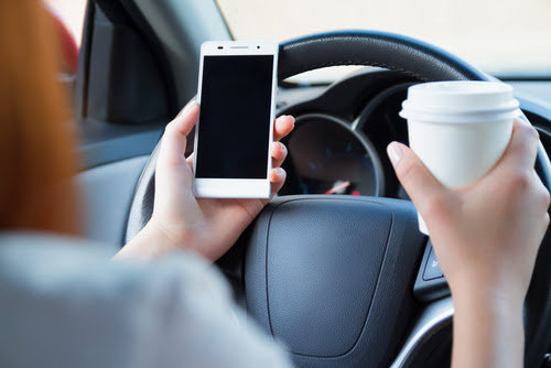 Top Five Distractions While Driving | Tampa Personal Injury Attorney