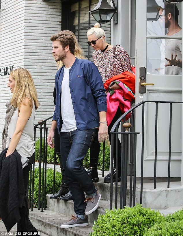 Family outing: Miley and Liam dined at Gracias Madre with Liam's brothers Chris (far right), Luke and Luke's wife Samantha (left)
