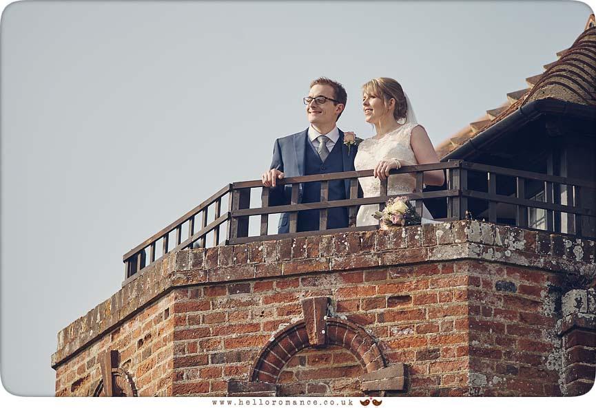 Bride and Groom on Balcony at Woodhall Manor - www.helloromance.co.uk