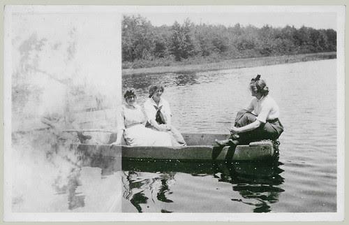 Three girls in a row boat