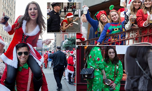 Hundreds in costumes revel at festive SantaCon