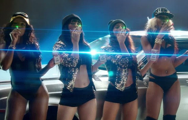 No cigar: Women in Lily's video wear skimpy outfits and light up electronic cigarettes beside a flashy car