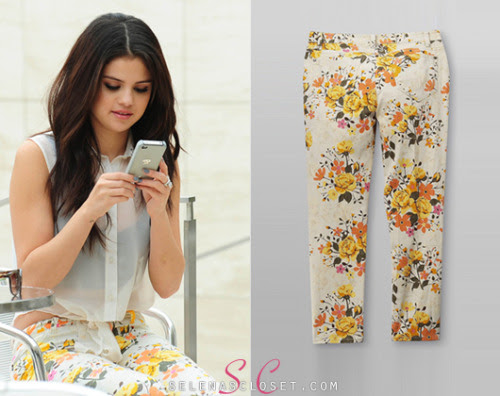 Our girl Selena Gomez looked more than camera ready on the set of her Dream Out Loud shoot. She embraced the current floral trend wearing a pair of Dream Out Loud Skinny Floral Pants in color Powder Puff. These pants are on sale from Kmart.com for $14.40. Buy it HERE. We're still waiting for her blouse to come into stock.