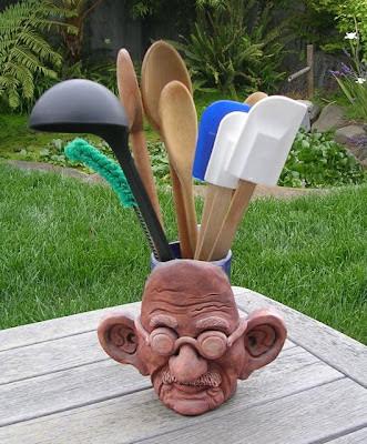 mug with Gandhi's face, serving as utensil holder