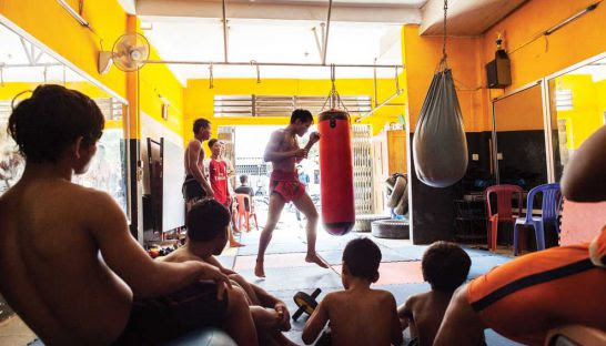 The Lord's Gym in Svay Pak offers local men – including sex traffickers – a chance to learn about boxing and Jesus.