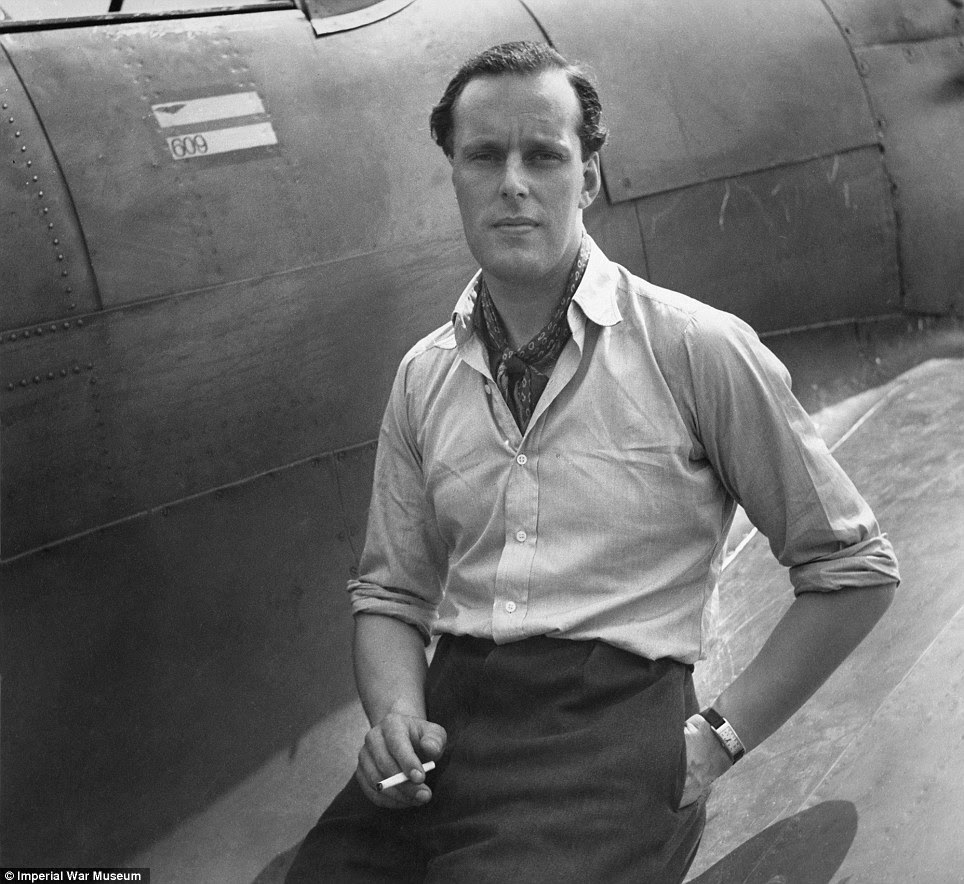 War heroes: Squadron Leader M L Robinson of No 609 Squadron RAF sits on the wing of his Hawker Hurricane at RAF Biggin Hill in 1941 for a relaxed portrait picture