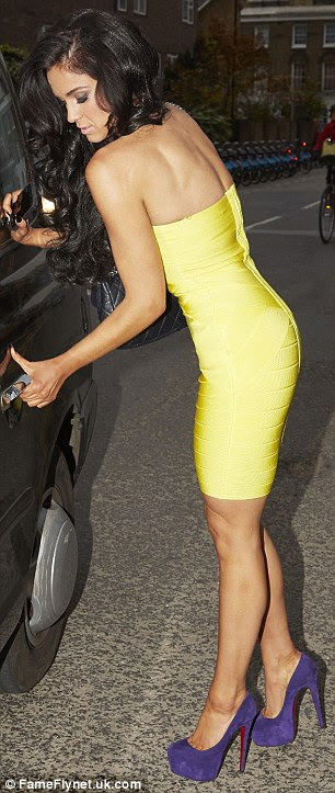 Skintight: Vicky looked amazing in her skintight yellow dress as she stepped into a taxi
