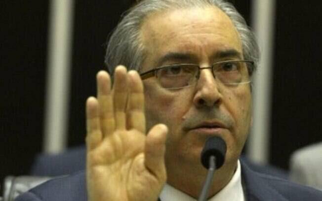 O deputado Eduardo Cunha (PMDB-RJ) na sessão em que leu o pedido de impeachment da Dilma: segundo a presidente, o parlamentar fez um achaque ao Planalto. Foto: Agência Brasil