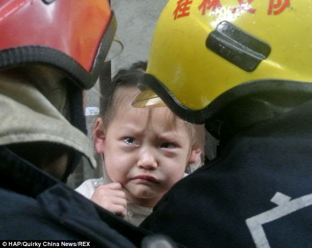Emergency services were called when passersby heard the three-year-old cries for help