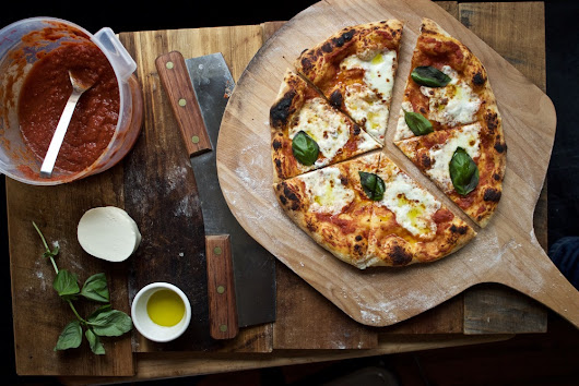 Practice The Art Of Making Pizza At Home