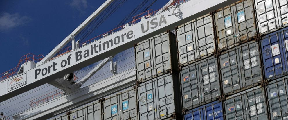 In this Oct. 24, 2016, photo, a crane hangs over a container ship at the Port of Baltimore in Baltimore. On Friday, Aug. 4, 2017, the Commerce Department reports on the U.S. trade gap for June. (AP Photo/Patrick Semansky)