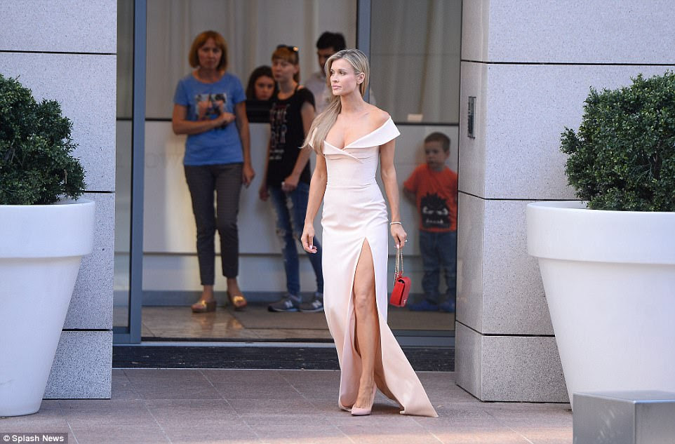 VIP guest: Polish-American model and actress Joanna Krupa led the arrivals ahead of the Queen's Birthday Party at the Orangery in picturesque Łazienki Park on Monday night, wearing a daring thigh-split dress with a plunging neckline
