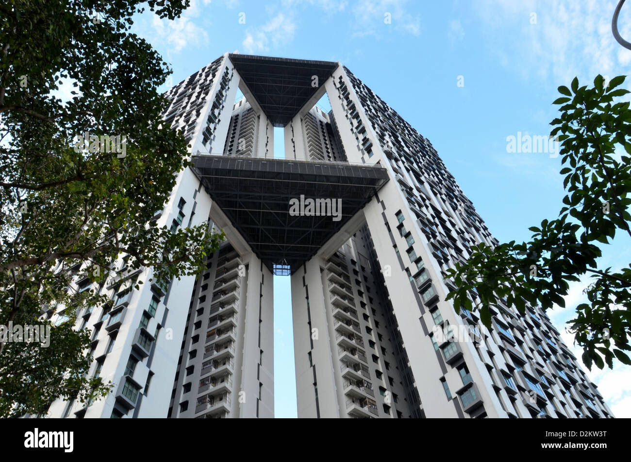 An imposing view of a modern high rise apartment building ...