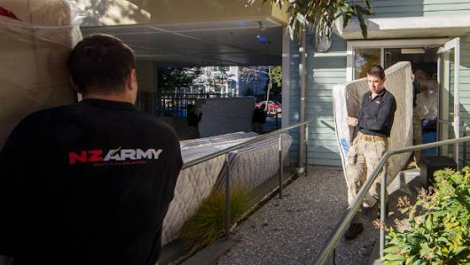 Soldiers deliver beds for needy families
