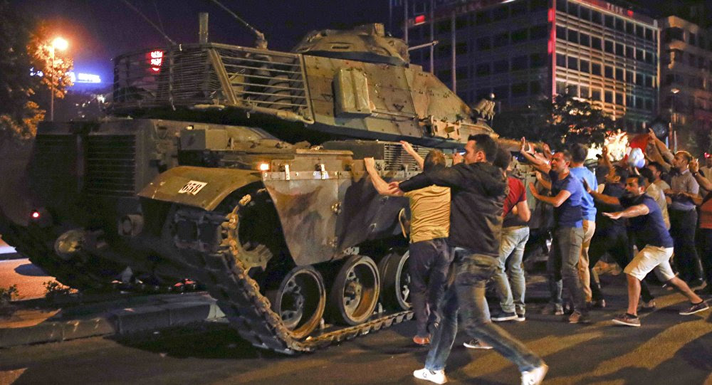 People React Near A Military Vehicle During An Attempted Coup In Ankara