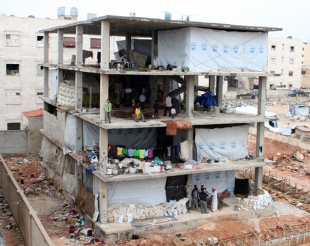 This half-built block of flats in Aleppo is home to around 20 families, many of whom have been displaced several times. The buildings have no walls, as winter sets in.