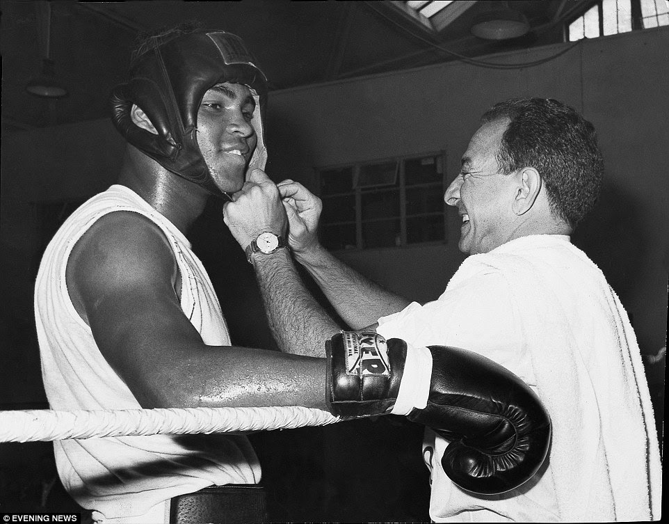Ali and trainer Angelo Dundee (right) are pictured before the first meeting with Henry Cooper in 1965