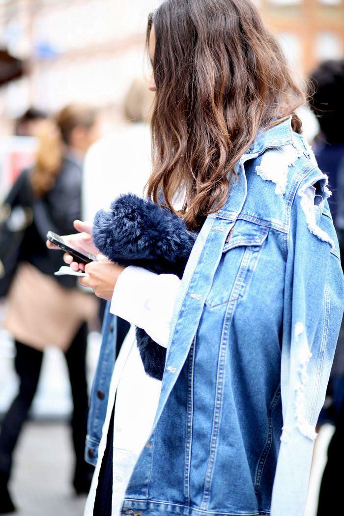 Le Fashion Blog -- Street Style: Distressed Denim Jacket and Fur Clutch -- London Fashion Week -- Via Elen Kristvik -- photo Le-Fashion-Blog-Street-Style-Distressed-Denim-Jacket-Fur-Clutch-London-Fashion-Week-Via-Elen-Kristvik.jpg