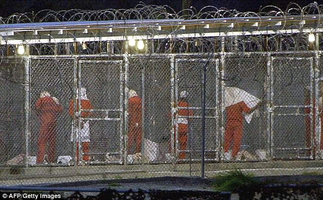 Detainees atCamp X-Ray in Guantanamo Bay were shackled to the floors while creating their art work, pictured here in a file photo from 2002 preparing for evening prayer