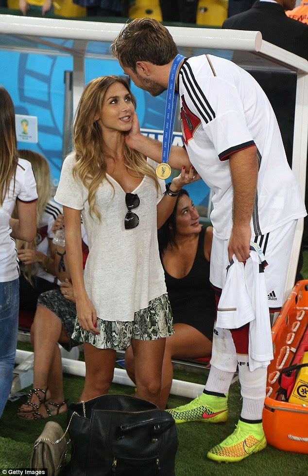 Glory: Ann celebrates victory with her beau after he won the 2014 FIFA World Cup in Brazil and afterwards the pair enjoyed a loved up holiday in Ibiza