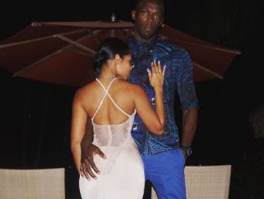 Usain Bolt's stunning girlfriend shares sweet snap of the sprint legend hand grabbing her bum as they celebrate his birthday