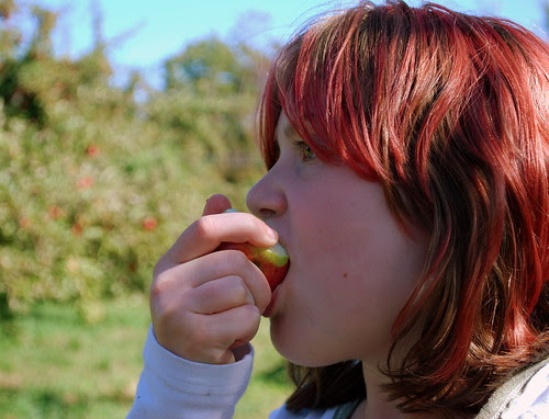 Apple Picking Sara apple in mouth