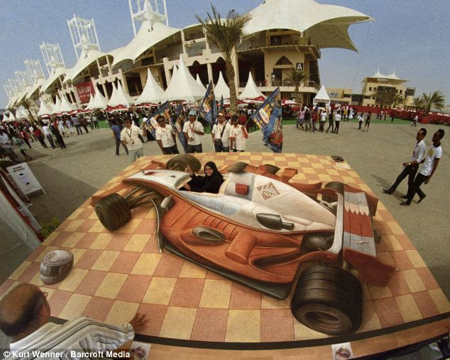 Incredible: A three-dimensional street painting called Women Driver photographed at Bahrain Grand Prix in Bahrain