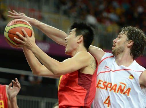 Chinese guard Wang Shipeng (L) is challenged by Spanish forward Pau Gasol