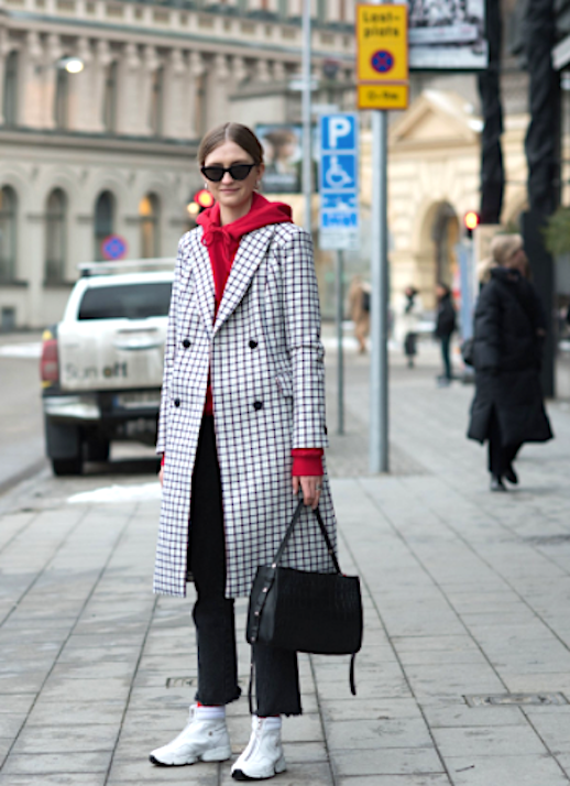 Le Fashion Blog Stockholm Fashion Week Cat Eye Sunglasses Long Black White Checked Coat Red Layered Hoodie Black Cropped Raw Hem Jeans White High Top Sneakers Via Vogue