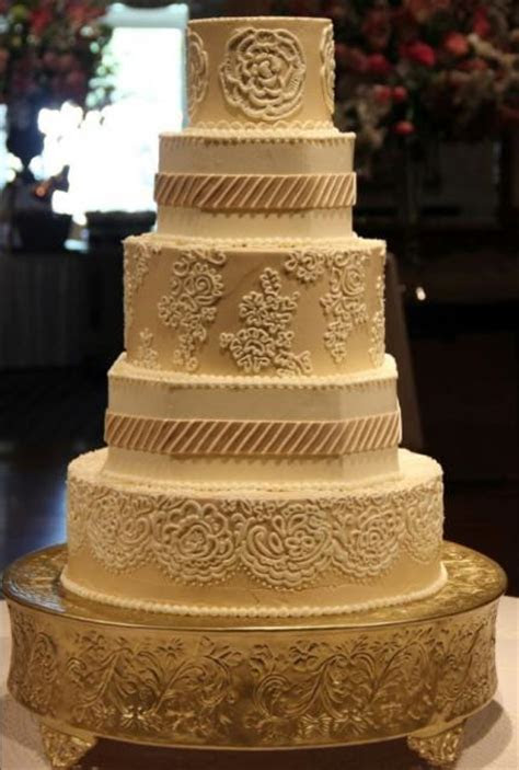 Coffee color engraved wedding cake in 5 tiers Hi Res