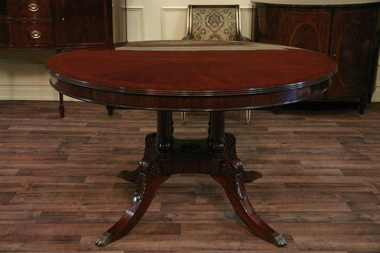 """54"""" Round to 90"""" Oval Mahogany Pedestal Dining Table with 2 Leaves"""