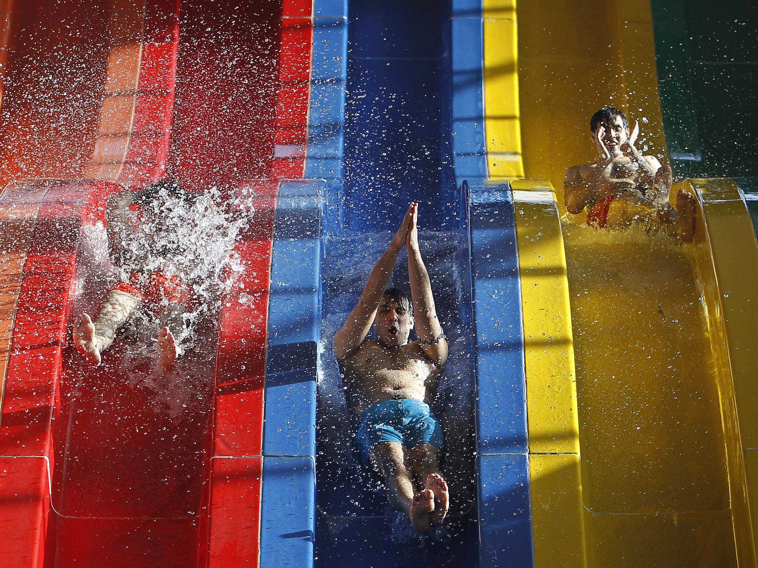 Kabul water park boys on slides