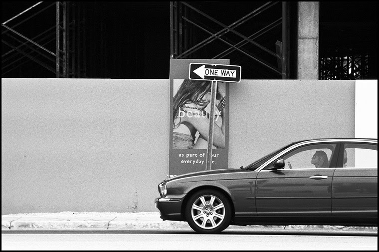 Woman riding BMW on NW 161st Street in Sunny Isles Beach, Miami, Florida, USA, 2007. Street Photography of Miami, San Francisco and Key West by Emir Shabashvili, see http://street-foto.com, http://miamistreetphoto.com, http://miamistreetphotography.com or http://miamistreetphotographer.com