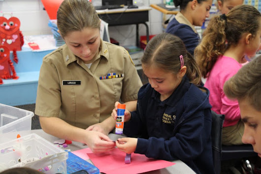 Upper School makes Valentine's Day cards with Lower School - Admiral Farragut Academy