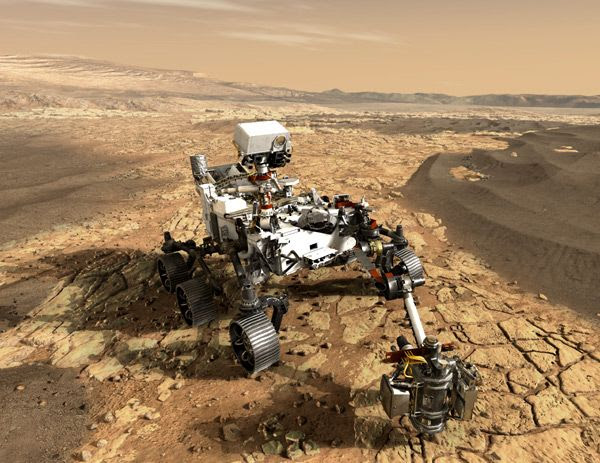 An artist's concept of NASA's Mars 2020 rover studying the surface of the Red Planet.