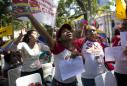 The Latest: China says dialogue only way to Venezuela peace