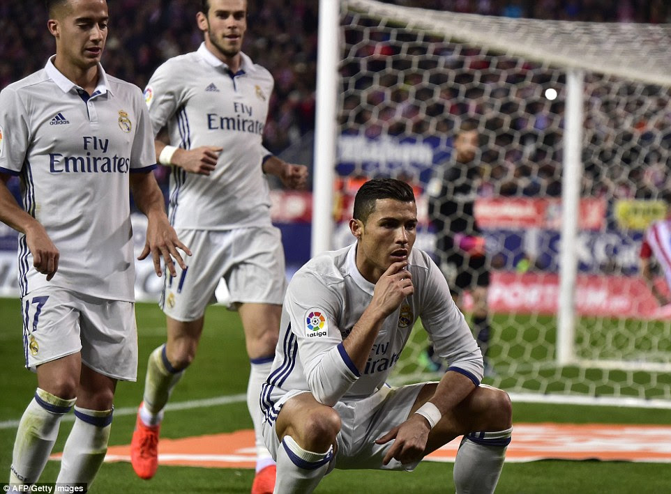 Ronaldo poses in front of the cameras after dispatching his penalty beyond Jan Oblak and into the back of the net