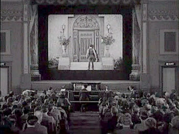 Buster Keaton about to climb into the cinema screen