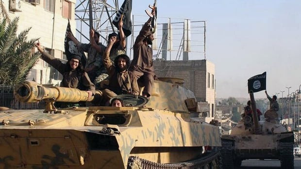ISIS fighters parade in Raqqa, Syria. The militant group is also known as ISIL, Islamic State, IS and now Daesh.